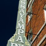 Green and yellow sign advertising the Hassayampa Inn