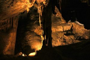 A lone stalagmite in Colossal Cave illuminated by a backlight.